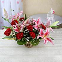 Round Basket Of 7 Pink Lilies & 7 Red Carnations